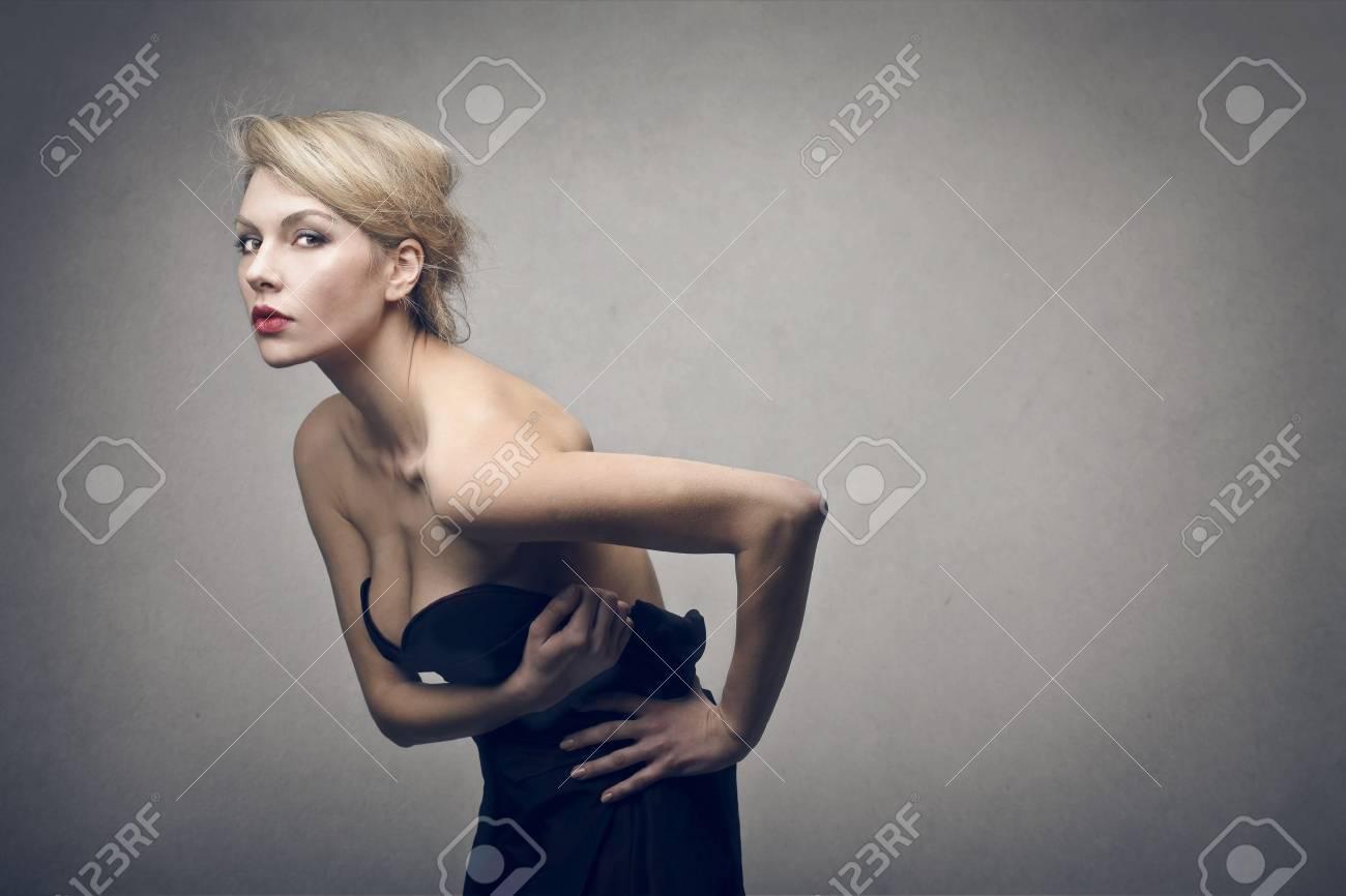 beautiful blonde woman on gray background Stock Photo - 18294885