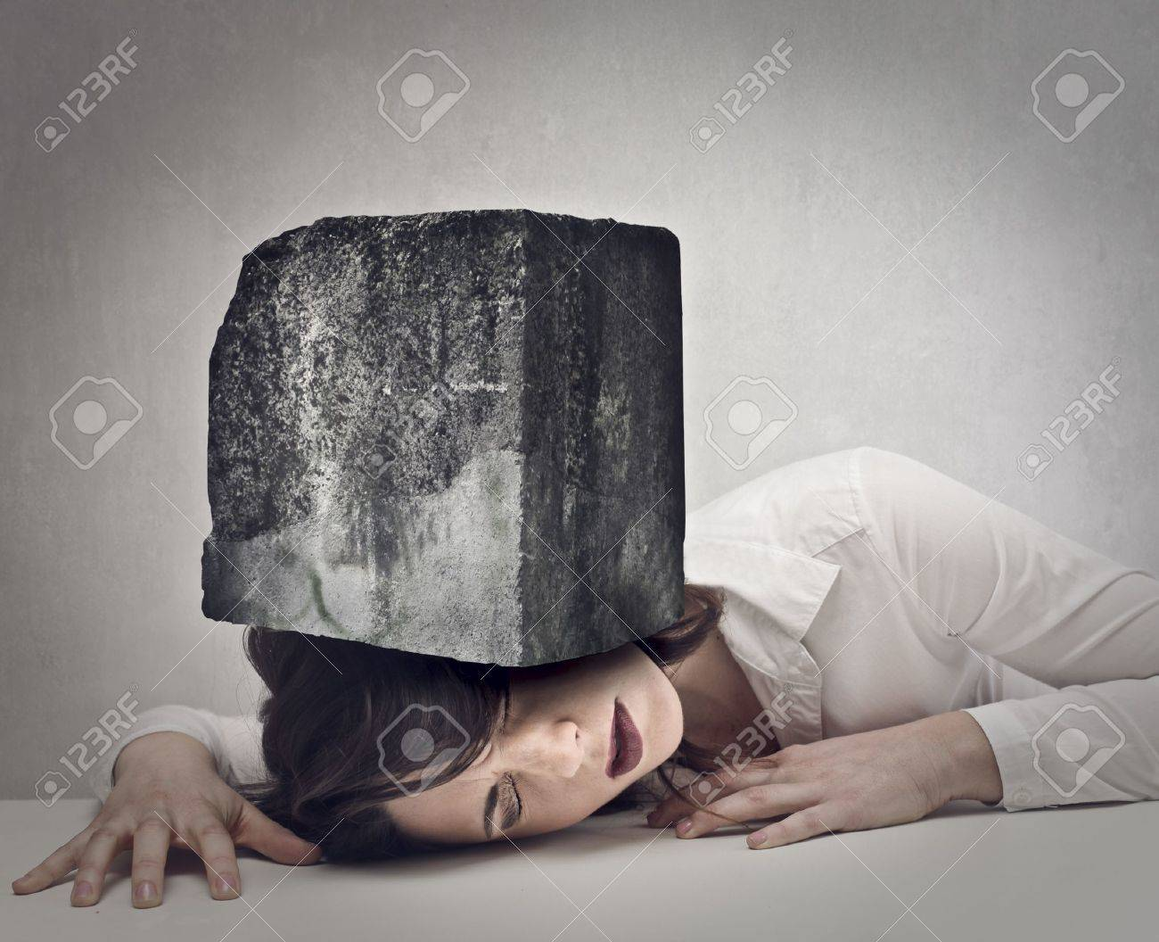 young woman with a big boulder above her head Stock Photo - 18675792