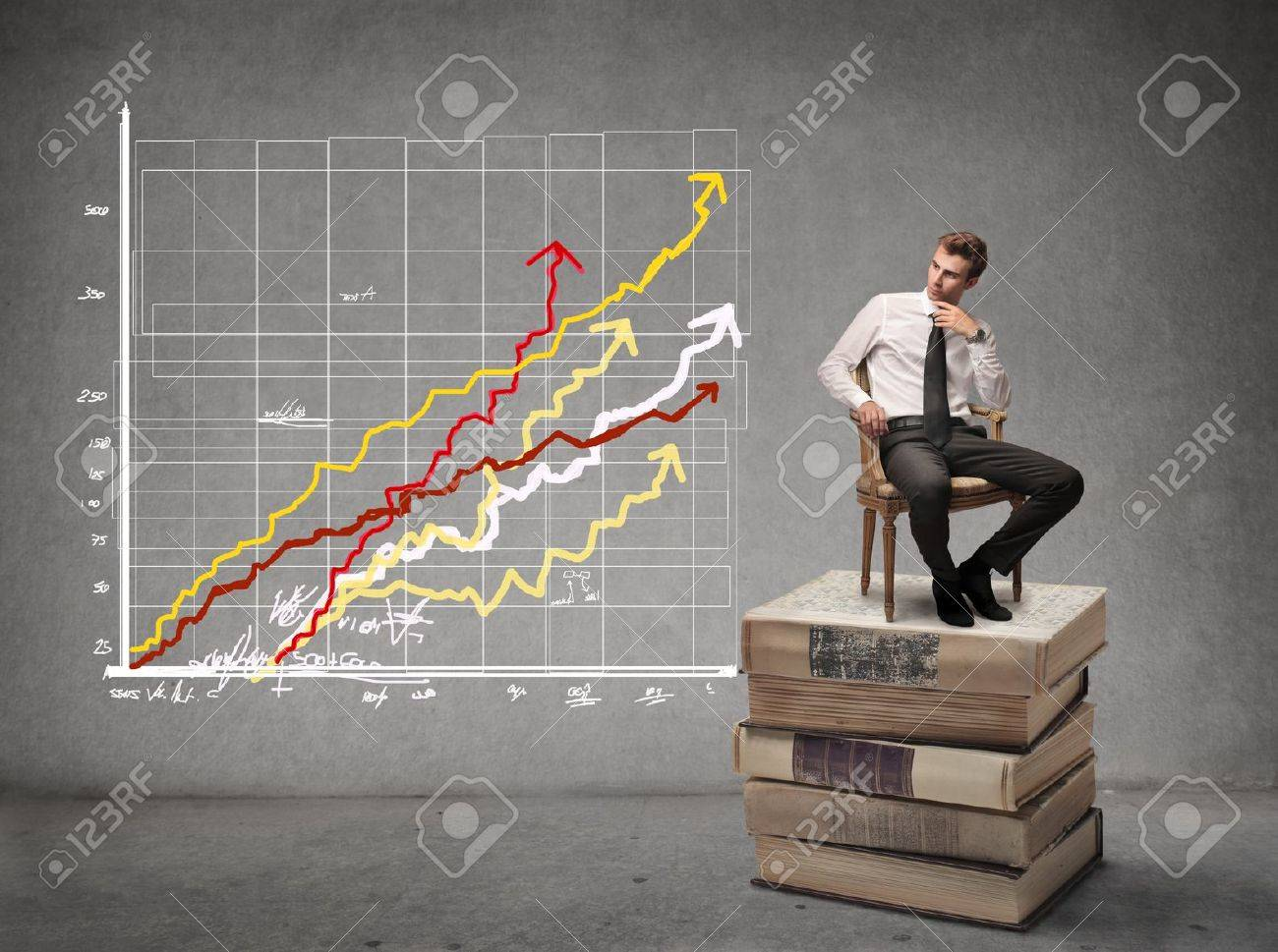 businessman looking at some graphics - 21803114