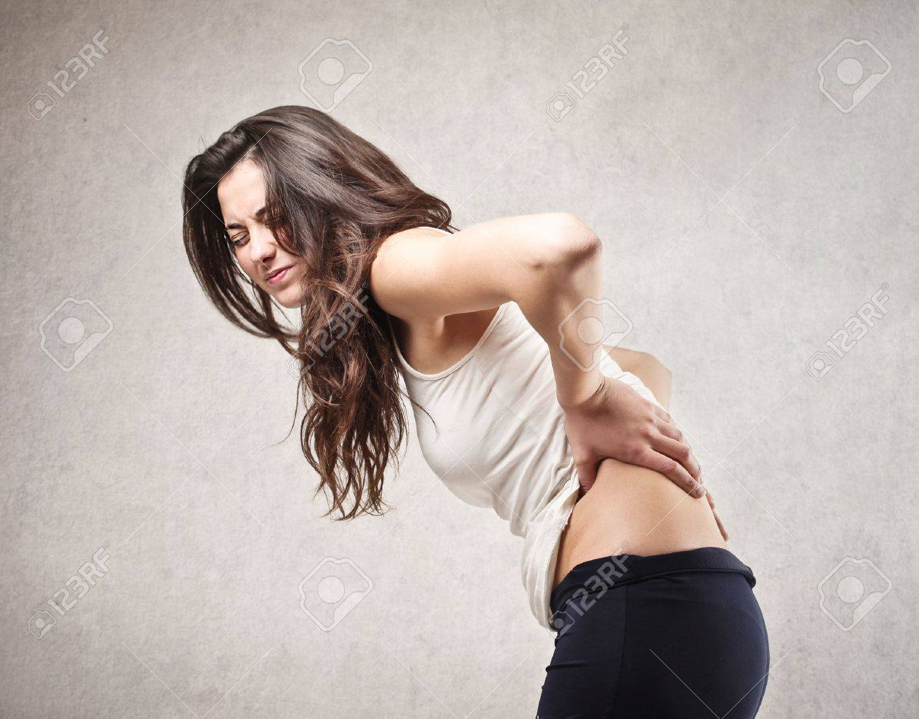 young woman with backache Stock Photo - 21803261