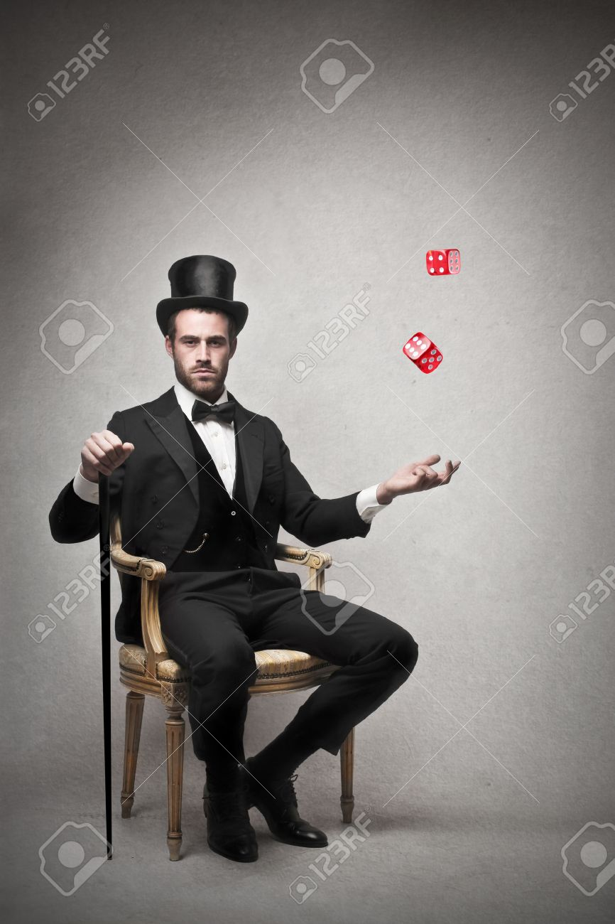 Rich Man Sitting On A Chair Throwing The Dice Stock Photo, Picture ...