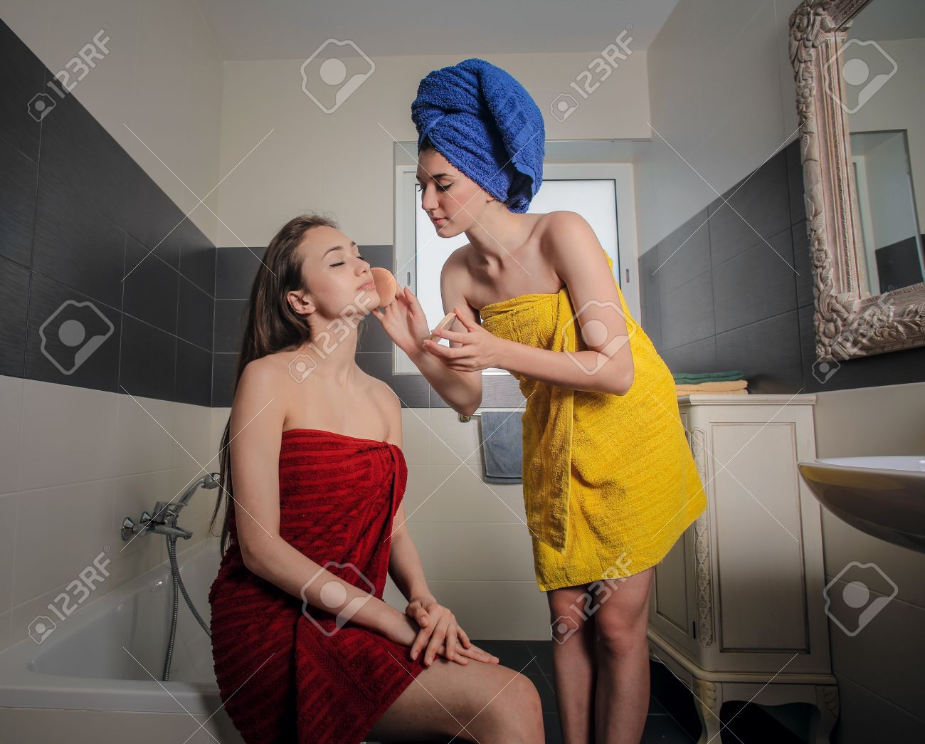 Girls In The Bathroom Getting Ready To Go Out Stock Photo   44205693