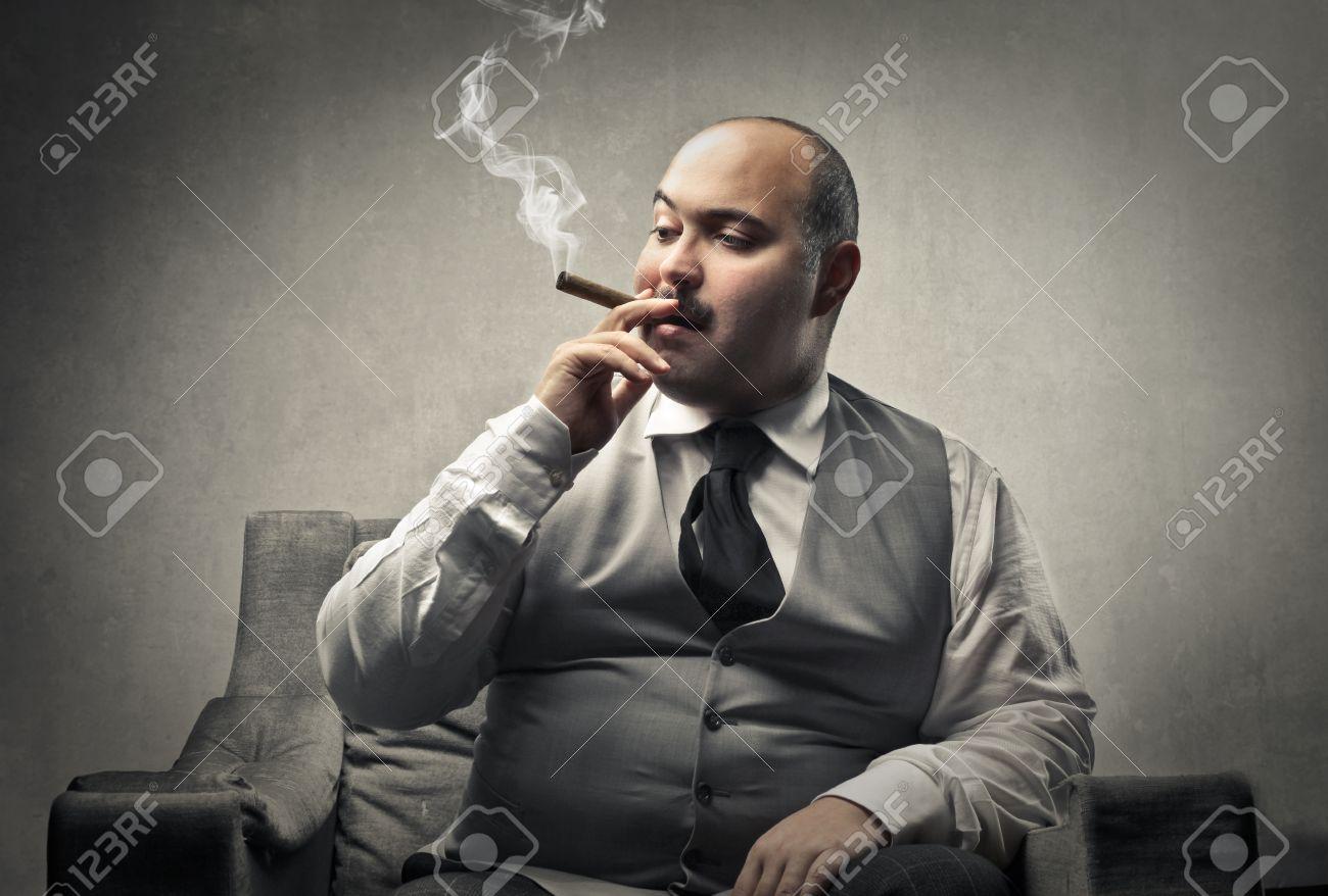 Fat man smoking a cigar - 50740739