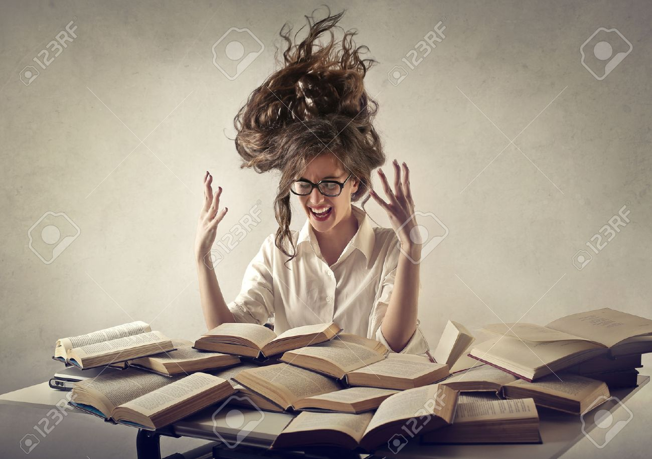 desperate woman trying to read books - 50741042