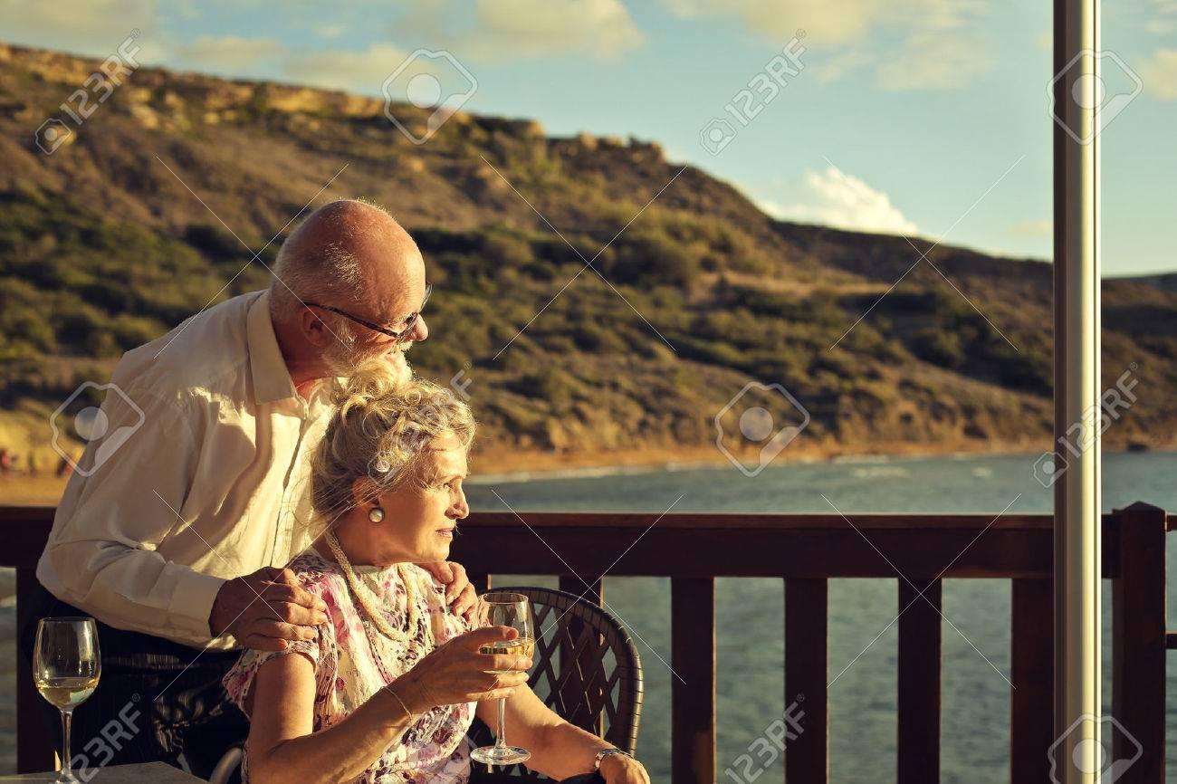 Elderly couple at the seaside Standard-Bild - 50741938