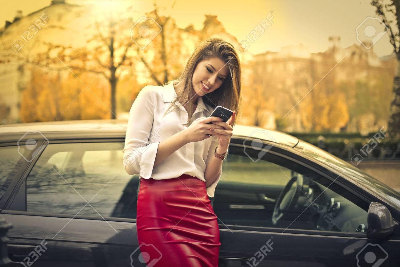 Happy woman sending a text message Standard-Bild - 50741950