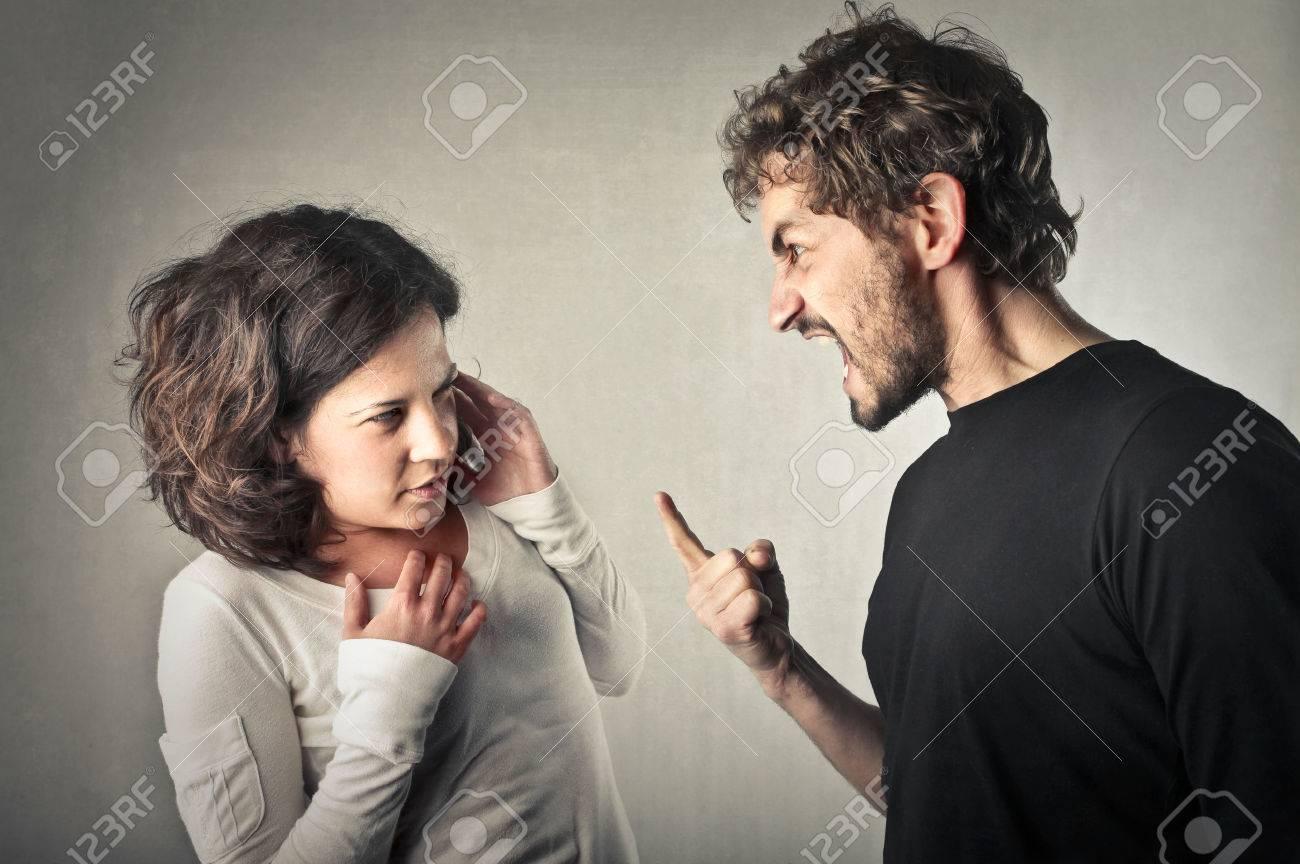 Angry man shouting towards his girlfriend - 50743653