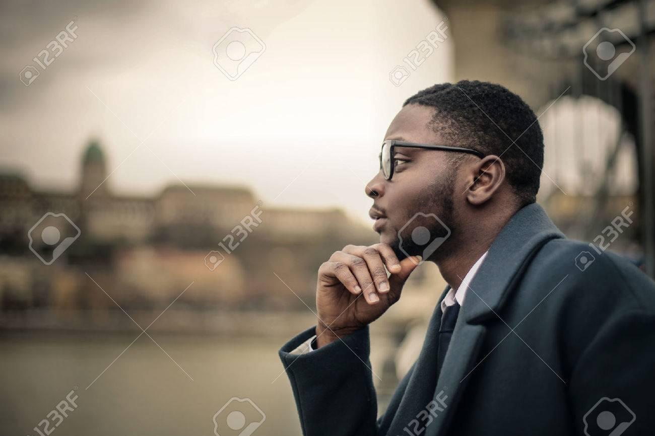 Businessman thinking in the open air Standard-Bild - 59114520