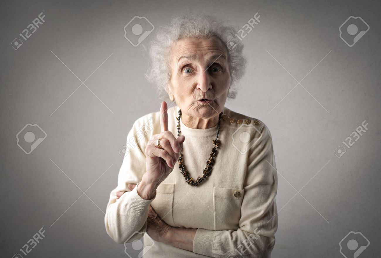 Severe grandmother pointing at someone Standard-Bild - 59244053