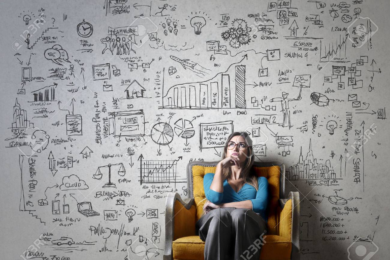 Woman thinking of a business idea Standard-Bild - 59829436
