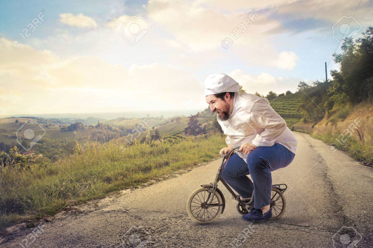 Cook riding a small bike - 59926892