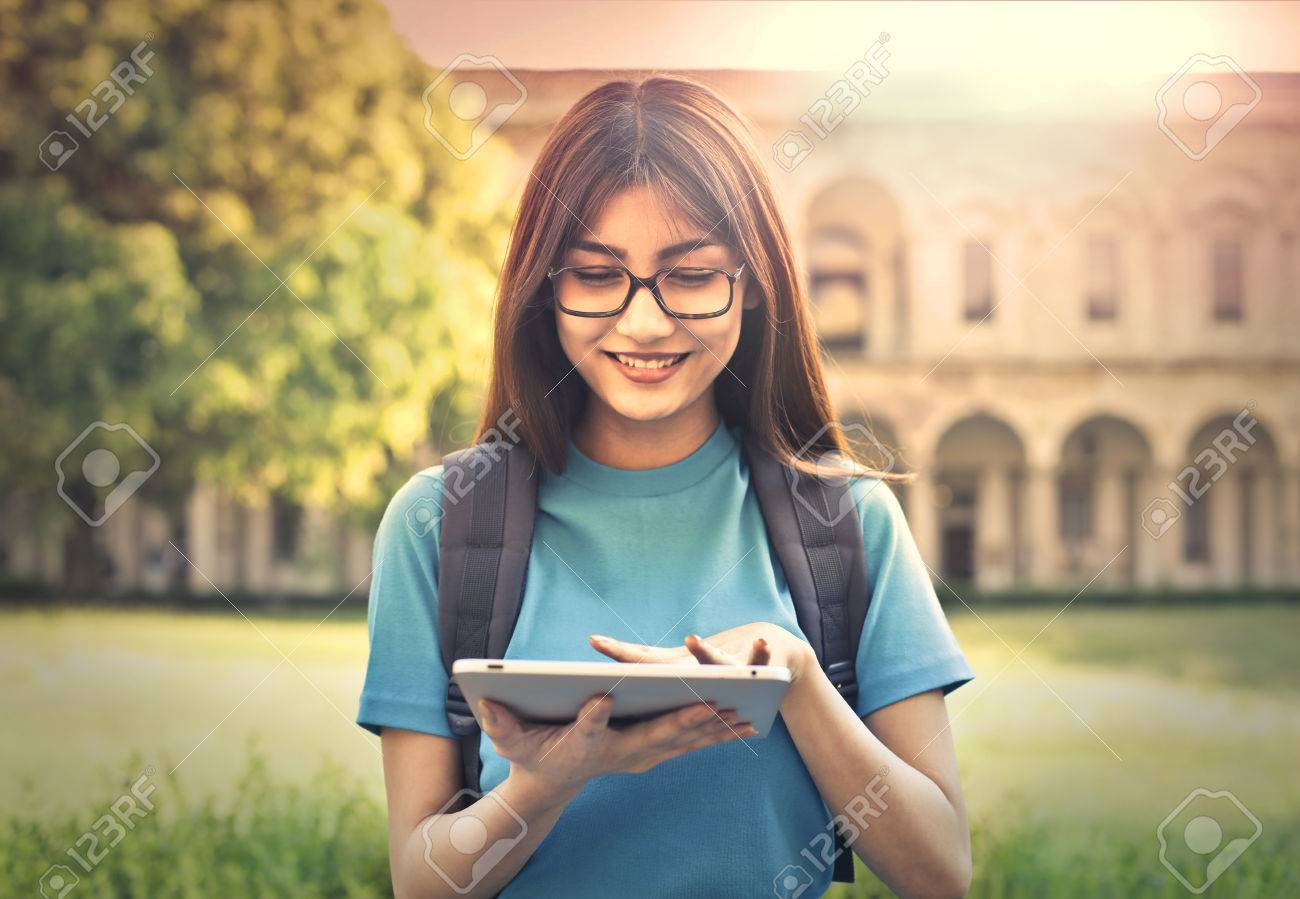 Young student using a tablet Standard-Bild - 59828614