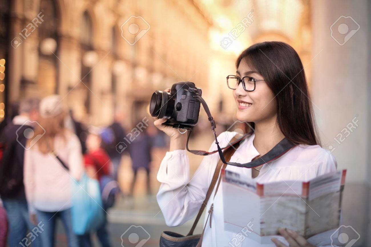 Tourist photographing a monument Standard-Bild - 63848096