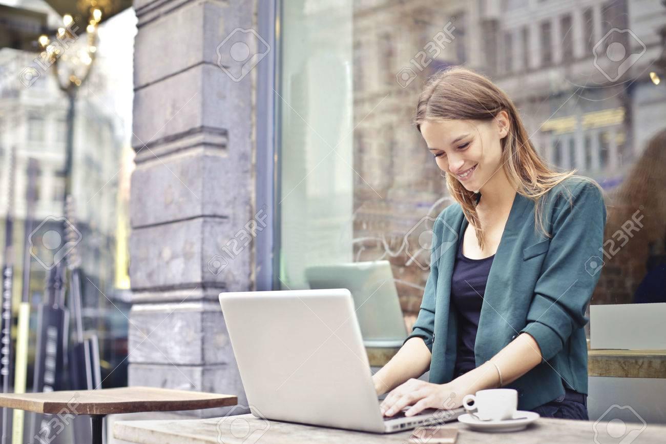 Woman working on her laptop Standard-Bild - 63848525
