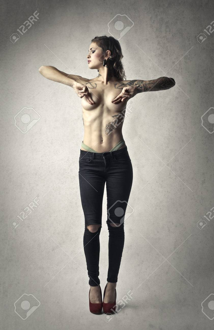 Tattooed girl naked posing