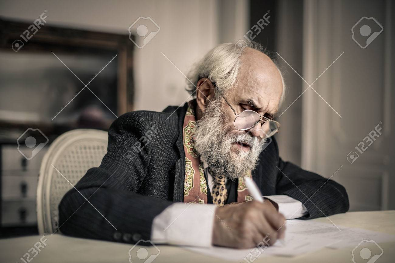 Old Man Is Writing A Letter Stock Photo, Picture And Royalty Free