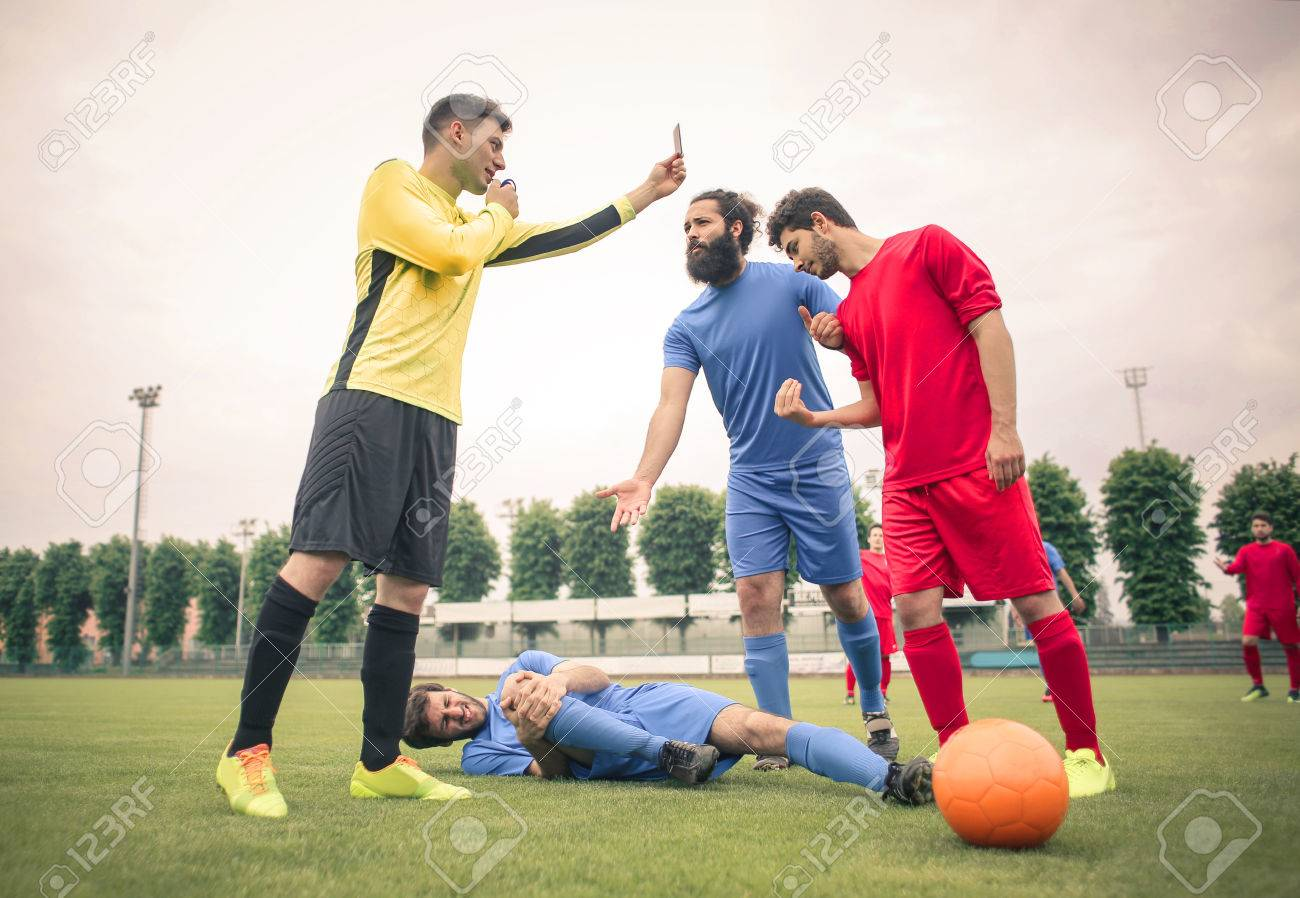 Soccer player on the ground - 81086517