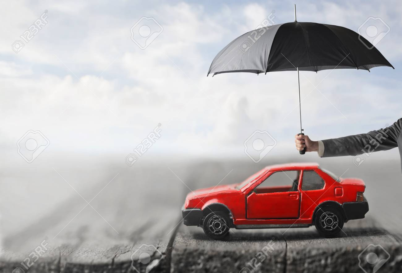Man is Protecting your car from the rain - 80320398
