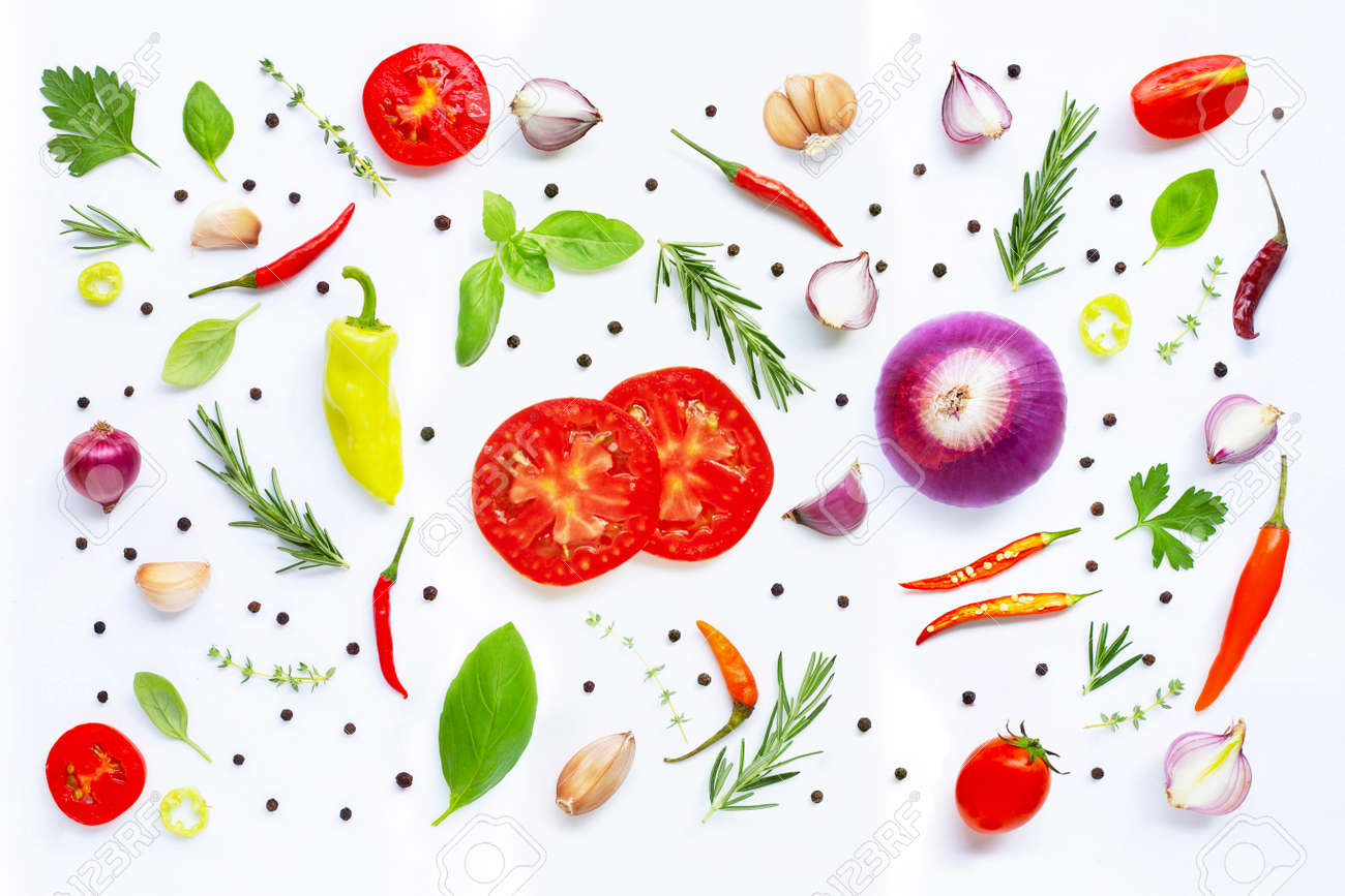 Various fresh vegetables and herbs on white background. Copy space - 128321646