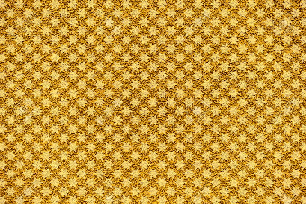 Golden revetment wall putty macro texture background white stars