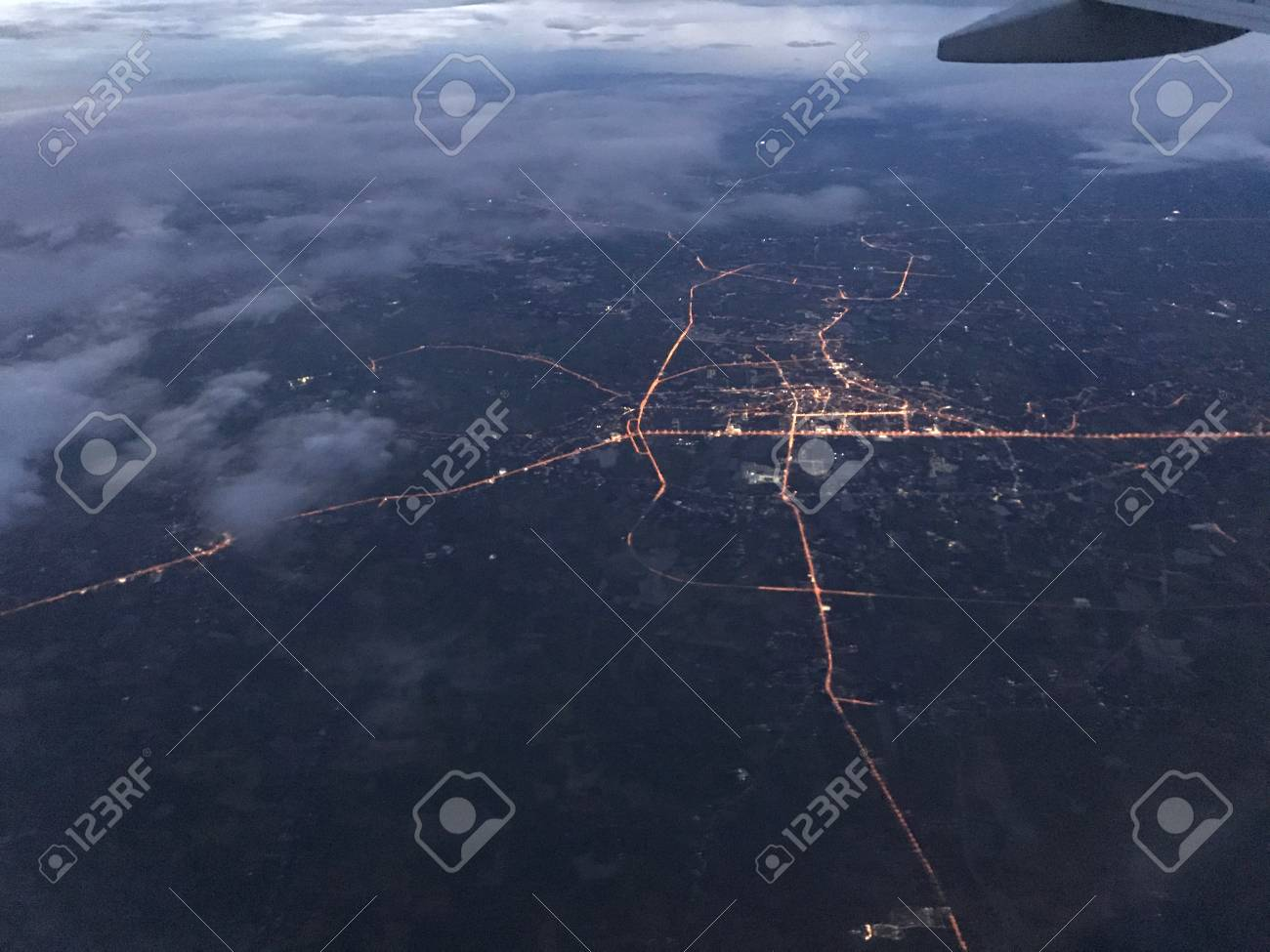 An Aerial Night View Which Took By Passenger On Window Seat Shows