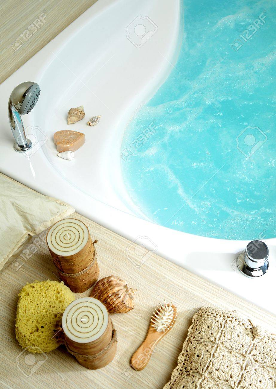 Bath Tub Filled With Water, With Candles, Sponge And Soap Stock ...
