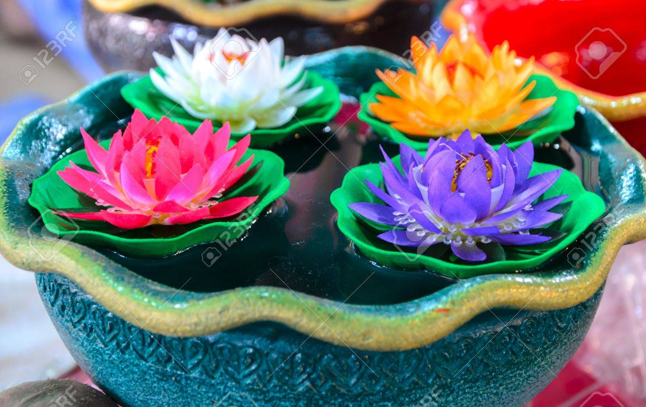 Colorful Artificial Plastic Lotus Flower Floating In A Bowl Stock