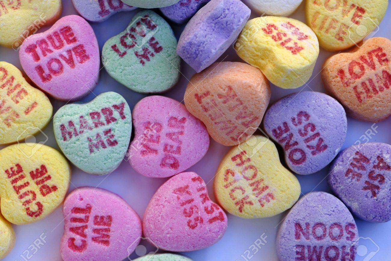 an isolated shot of love heart candy in different colors stock photo