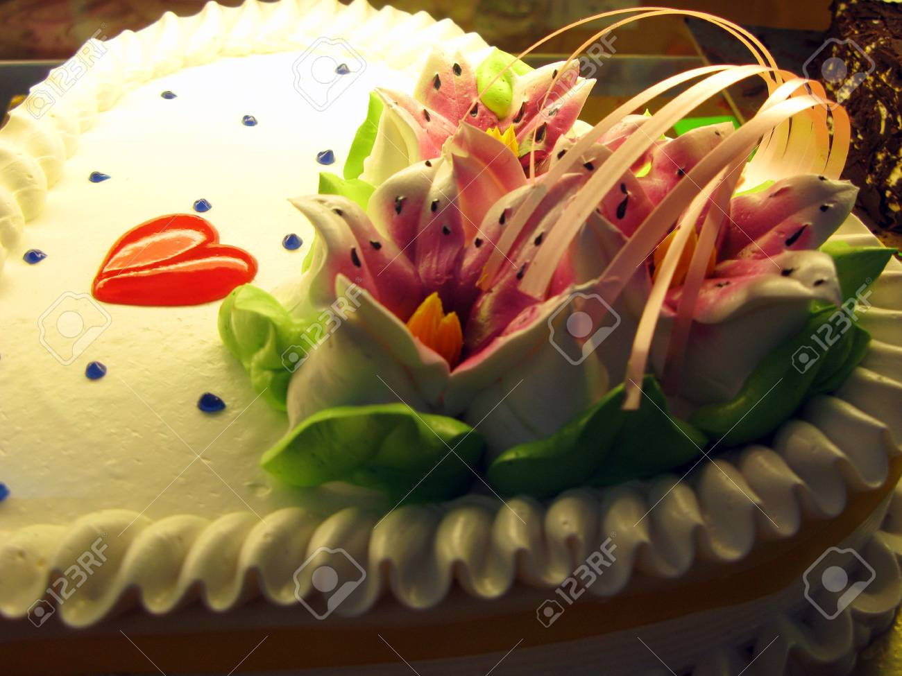 An Isolated Shot Of Heart Shape Birthday Cake Stock Photo Picture