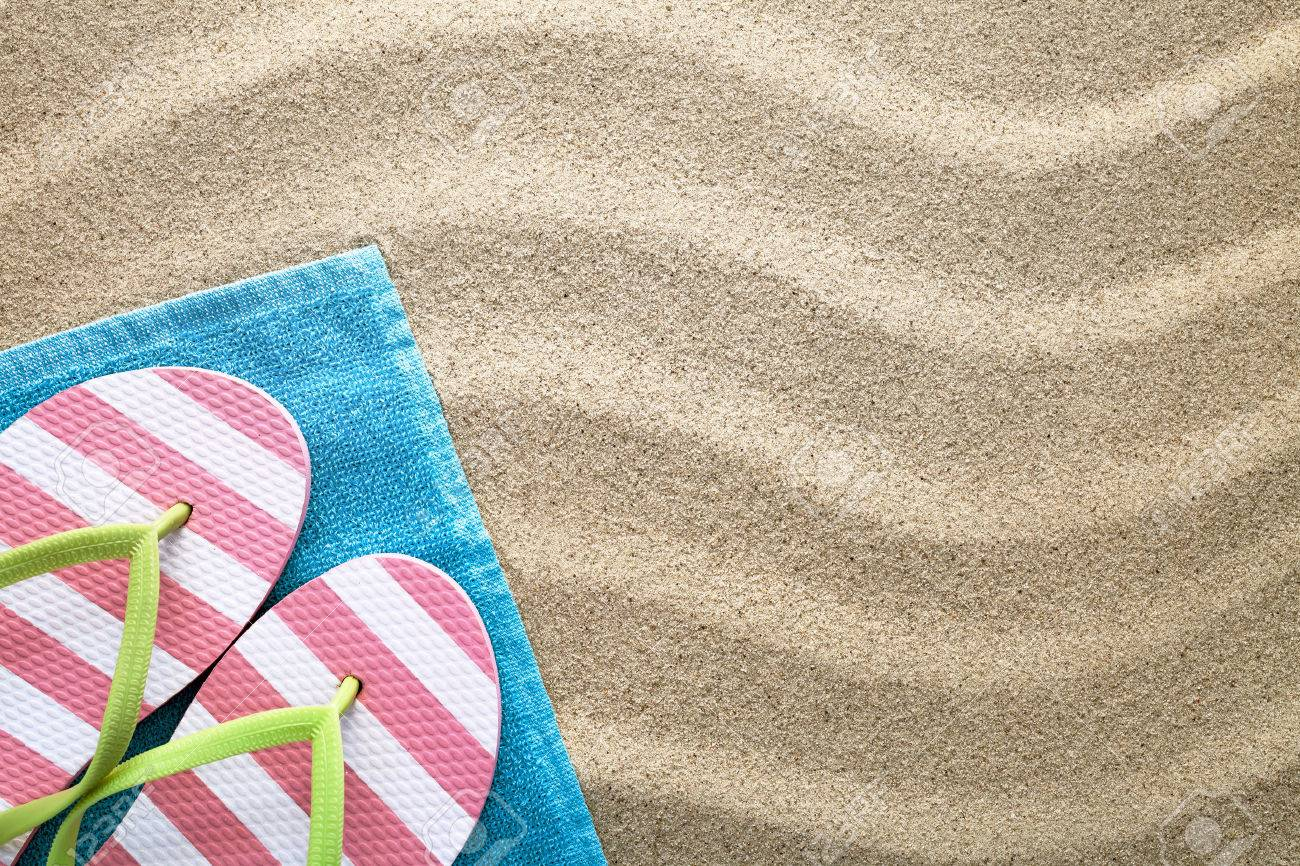 b0c0ee146a55 Beach background with towel and flip flops. Summer concept. Top view Stock  Photo -
