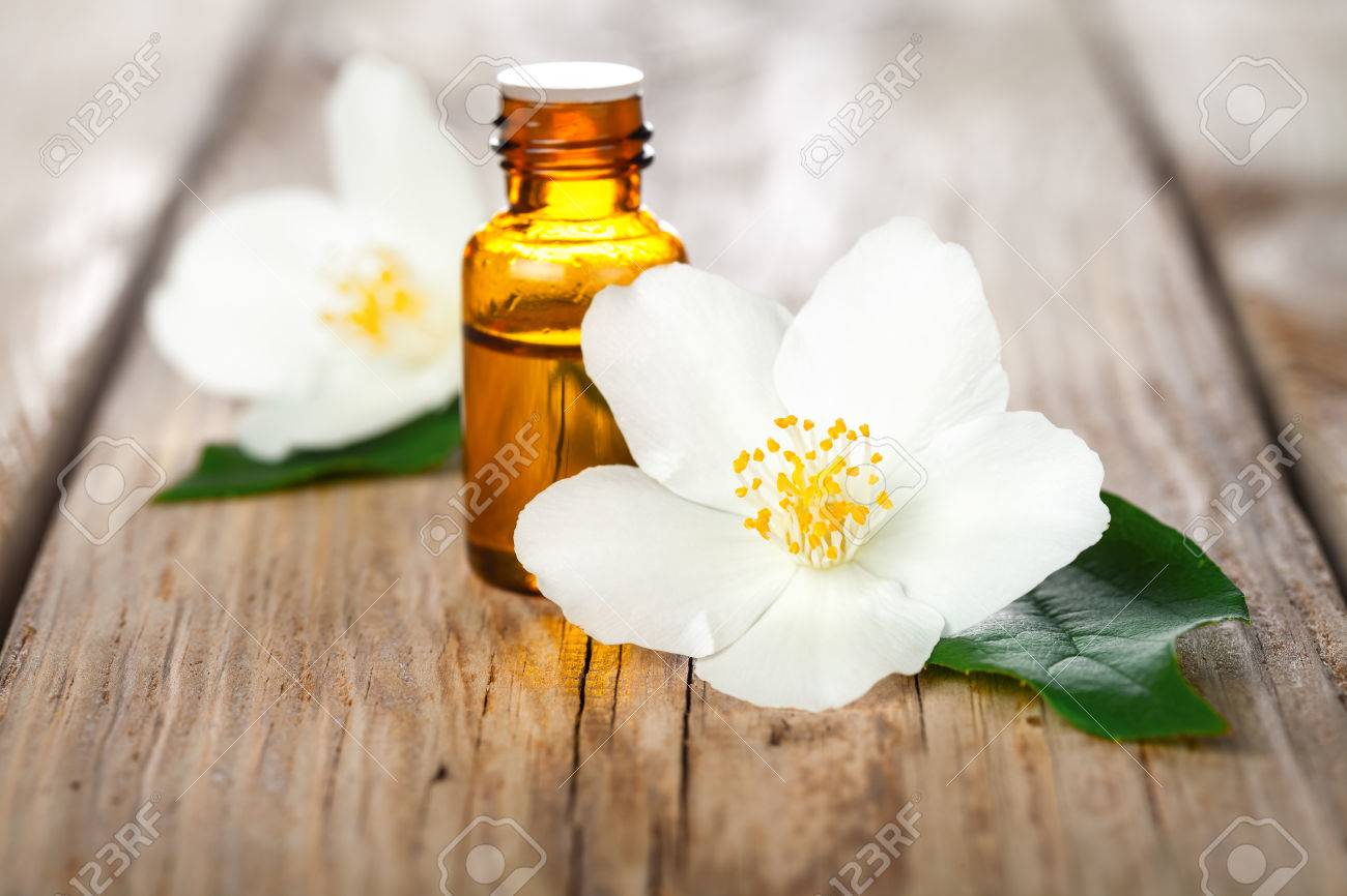 Jasmine Flowers With Essential Oil On Table Background Beauty