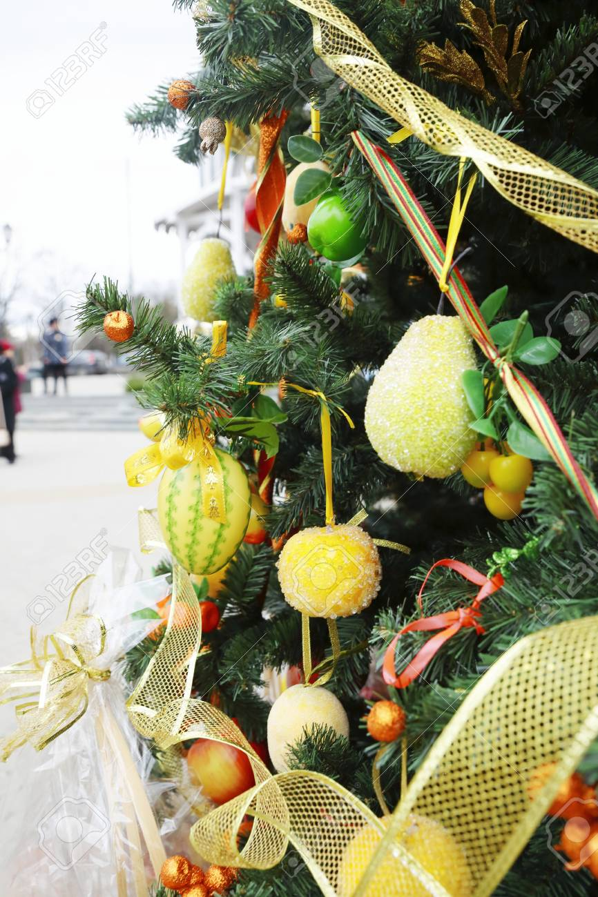 Christmas Tree Fruit Ornaments.Fragment Of Christmas Tree Decorated With Fruits And Vegetables