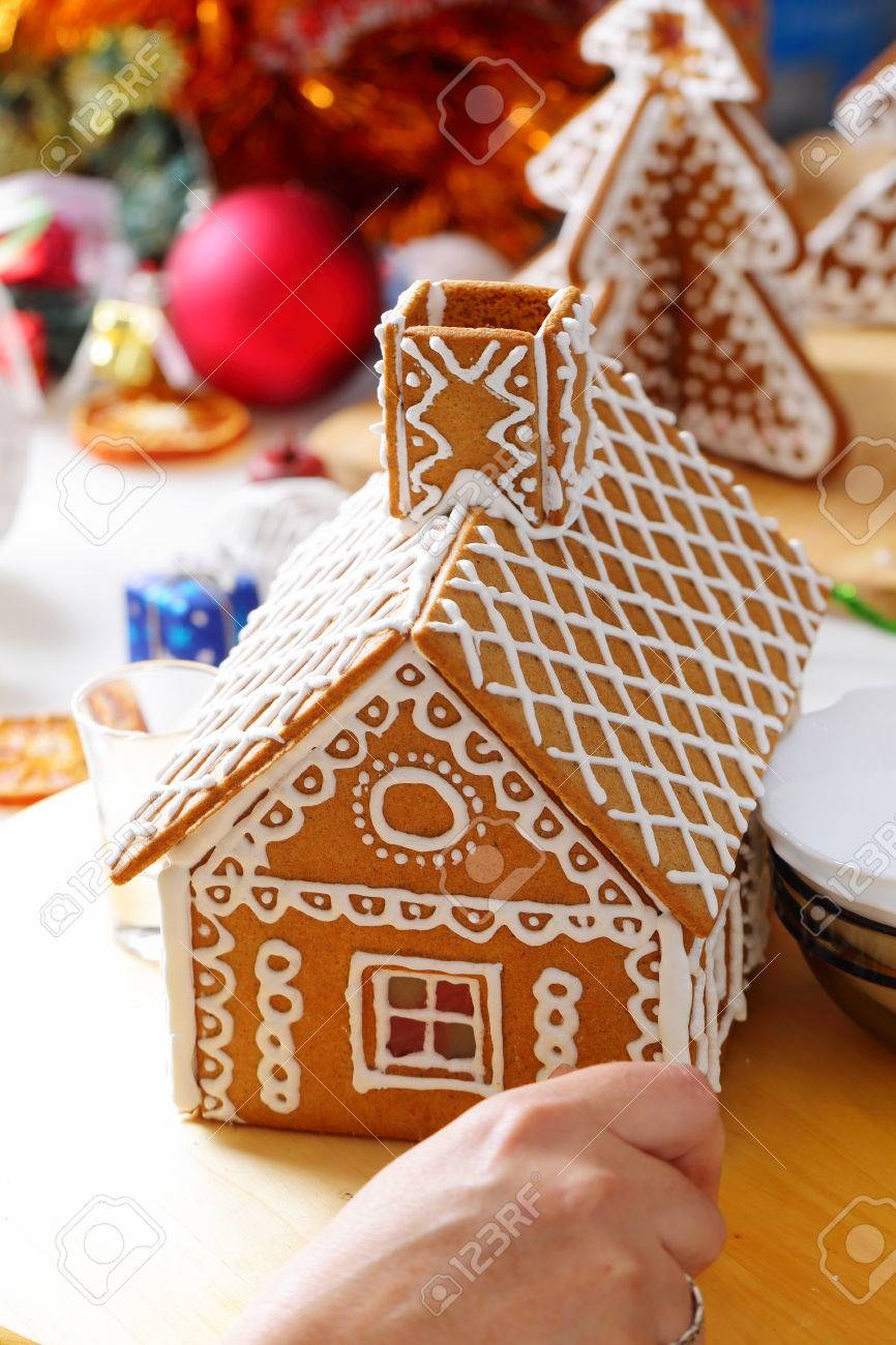 Making of christmas gingerbread house. Roof decorating. Close..