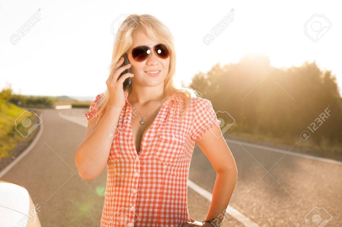 girl phones beside a car Stock Photo - 17718308
