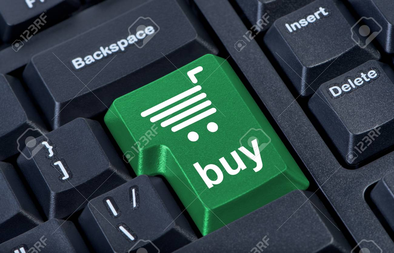 Computer keyboard with green key buy, internet trade concept. Stock Photo - 10002133