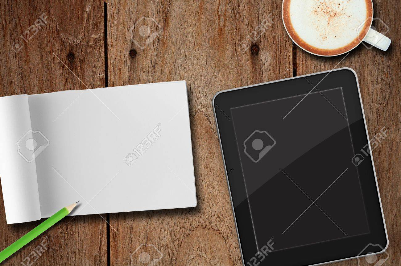 Tablet pc , note paper and coffee on table Stock Photo - 13267463