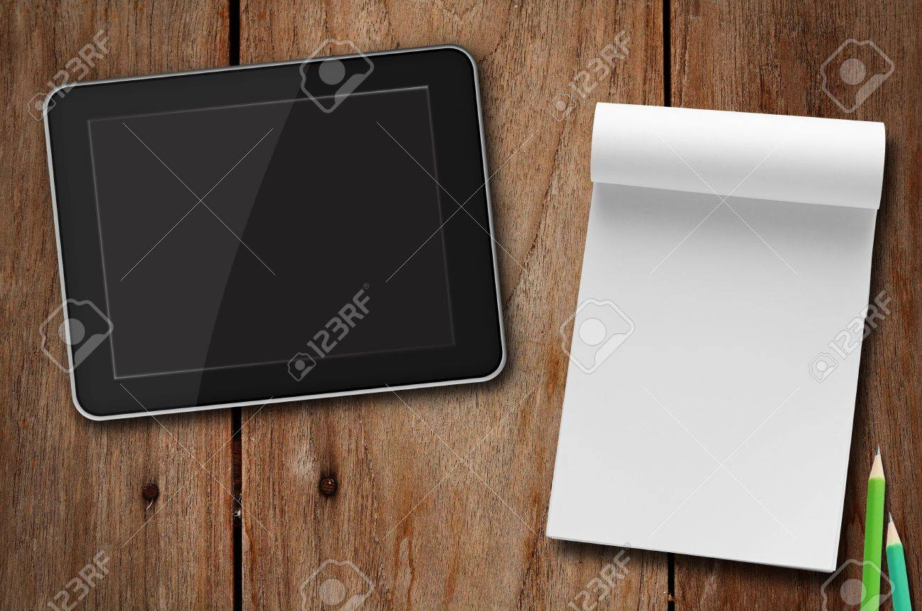 tablet pc  vs notepad paper Stock Photo - 13267462