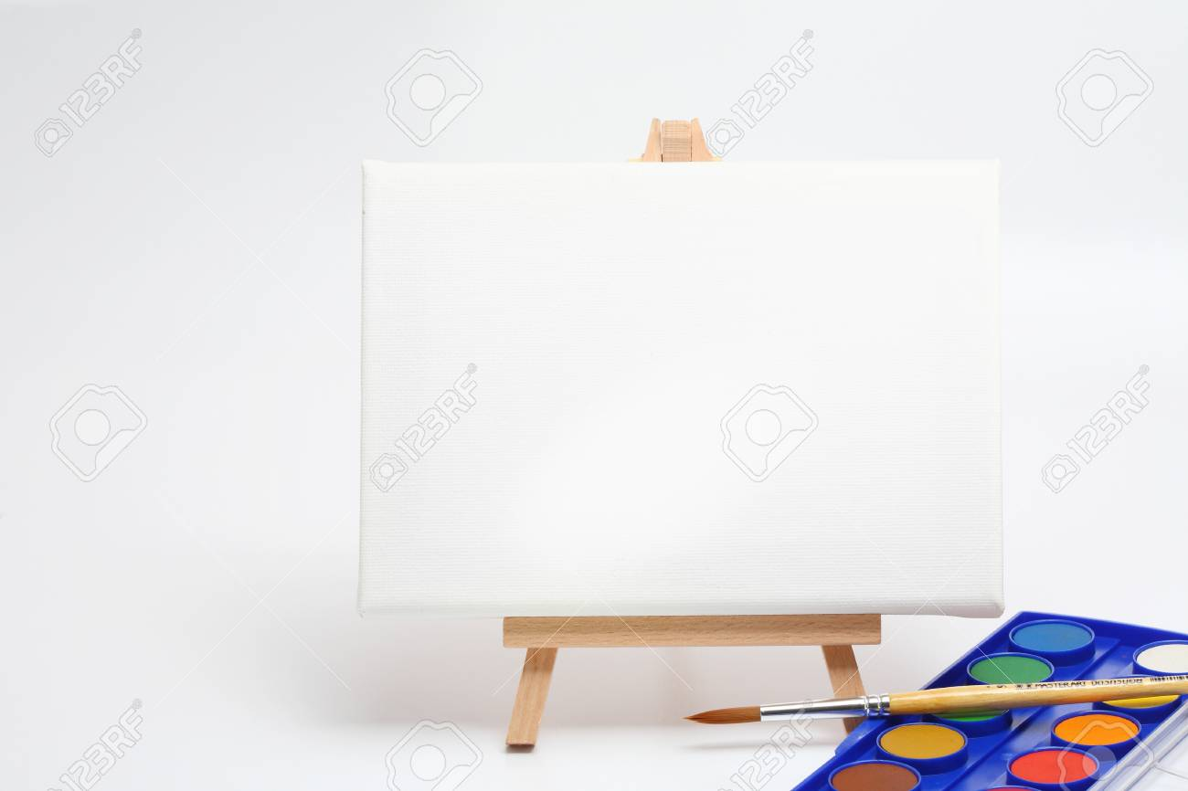 easel with brush and water colors isolated white Stock Photo - 13986971