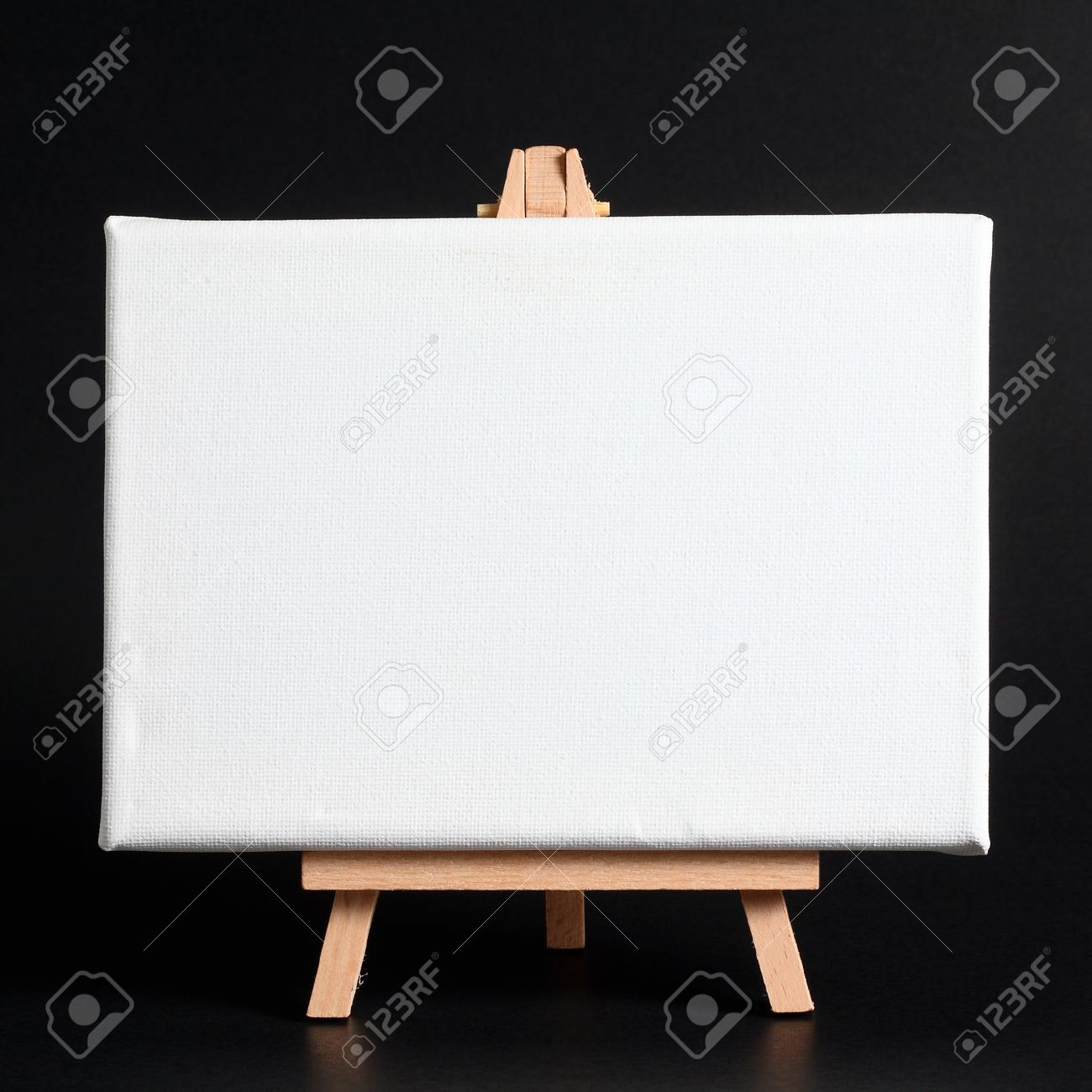 Wooden easel with blank canvas on a dark background Stock Photo - 14172481