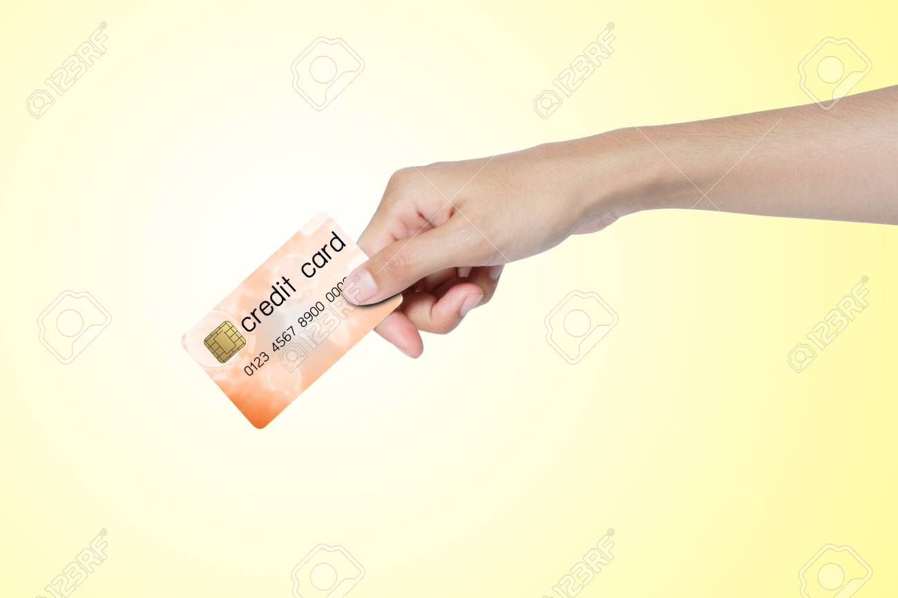 credit card holded by hand over blue background Stock Photo - 14459747