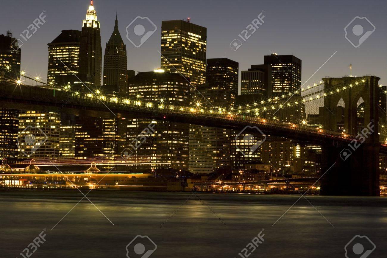 Downtown New York City Skyline And Brooklyn Bridge At Dusk Time