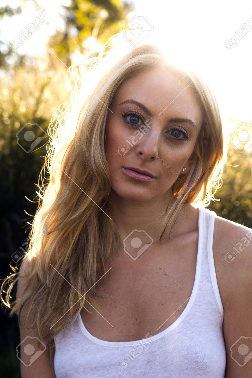 Beautiful adult woman outdoors, backlit by the sunrise/sunset Stock Photo - 10884424