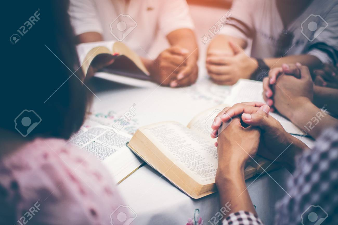 Christians are congregants join hands to pray and seek the blessings of God, the Holy Bible. They were reading the Bible and sharing the gospel with copy space. - 110707608