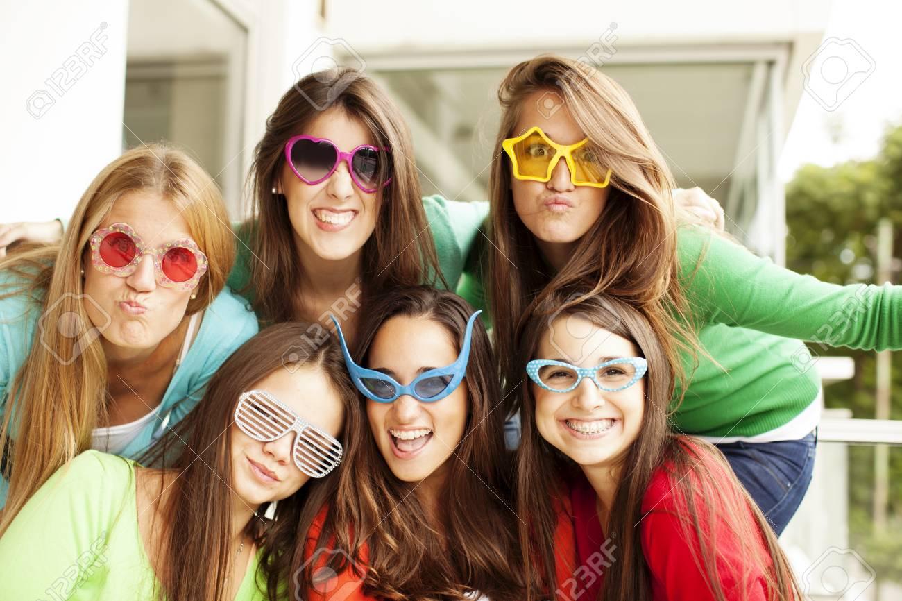 95b831f1aa17 Group of teen friends having fun wearing glasses Stock Photo - 63419643