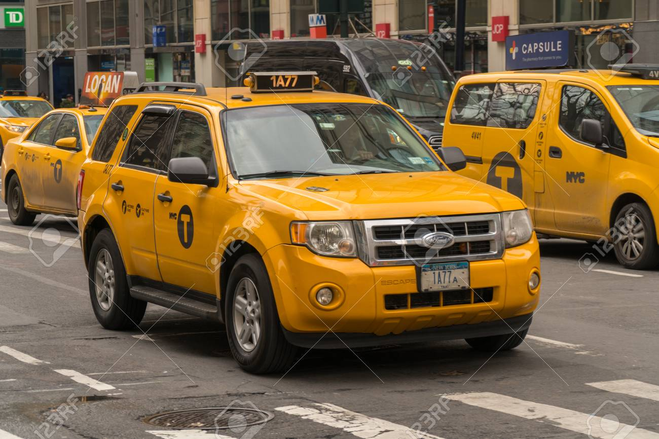 New York City - Circa 2017: Yellow taxi cab driving in streets