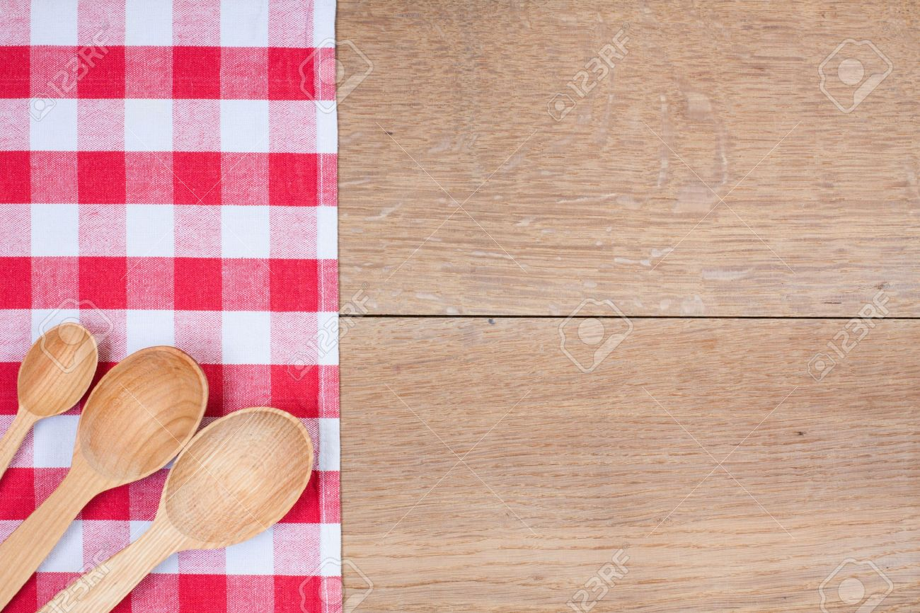 Red and white kitchen textile texture, wooden spoons on wood textured background Stock Photo - 15779374