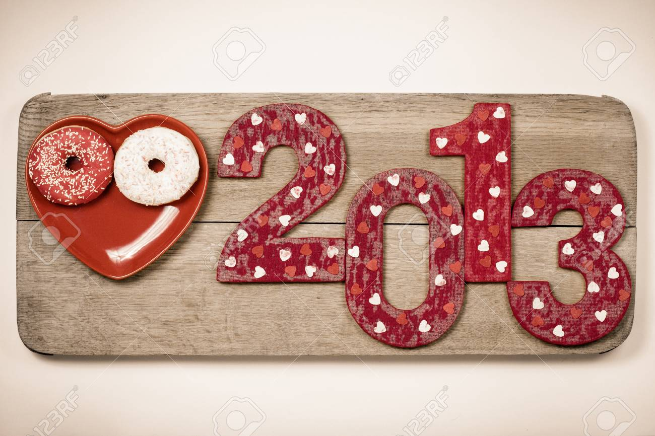 Vintage New Year 2013 snake date with on wooden board Stock Photo - 16997756