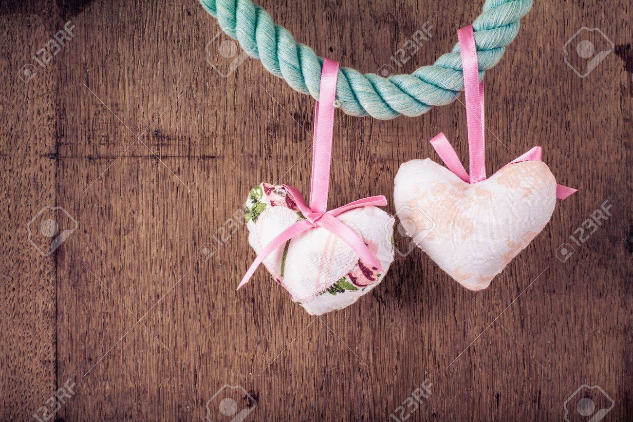 Vintage Valentine wooden background with hearts hanging on rope Stock Photo - 17627864