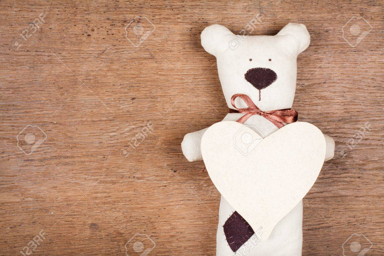 Valentine card with handmade bear and heart on wooden texture Stock Photo - 17725265