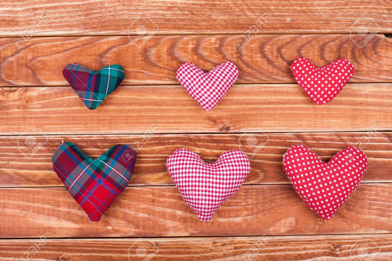 Handmade Valentine  hearts on wooden background Stock Photo - 17836100